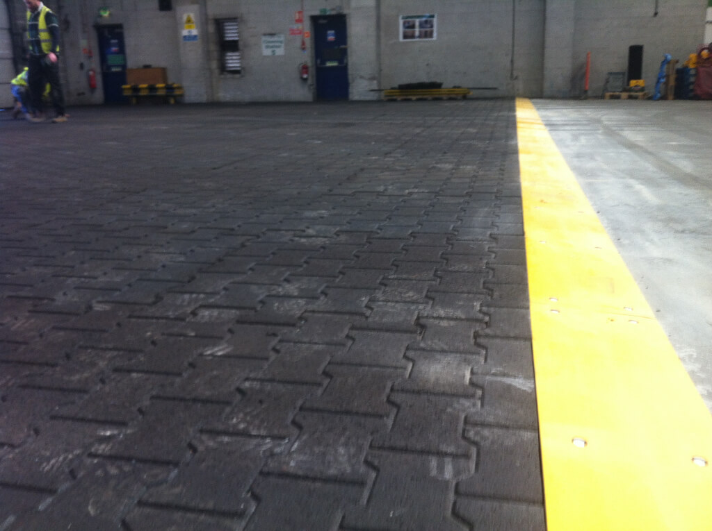 Rubber block pavers installed in a loading bay at a brewery