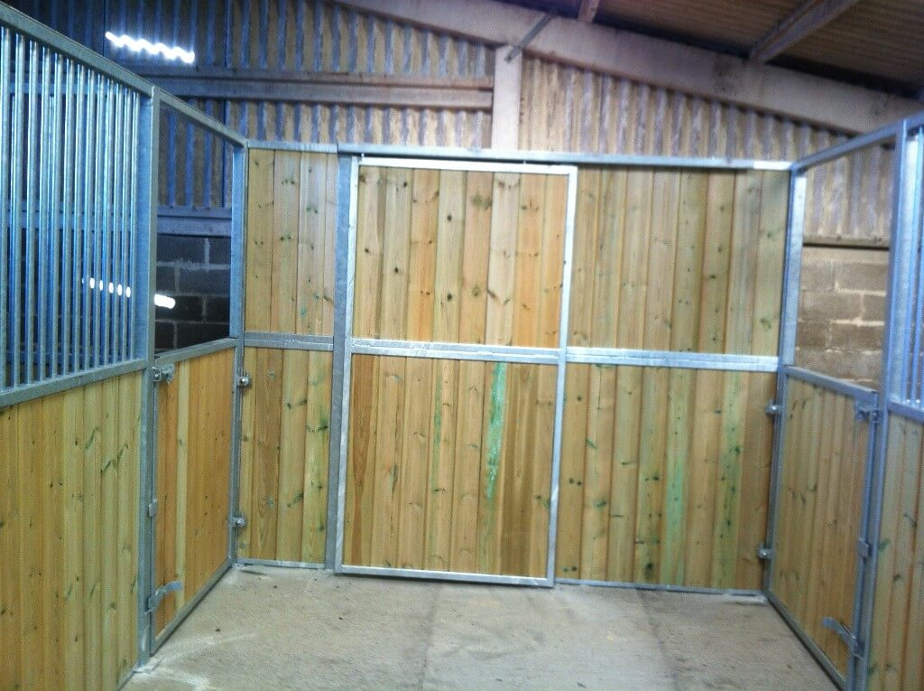 Internal sliding door accesses tackroom.