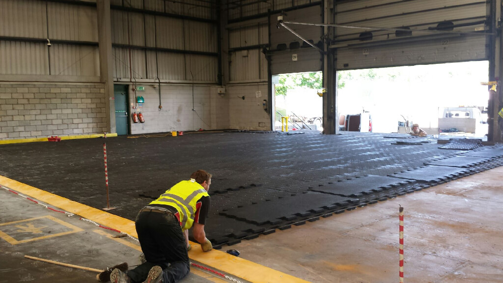 Installation of heavy duty rubber flooring in a brewery loading bay.
