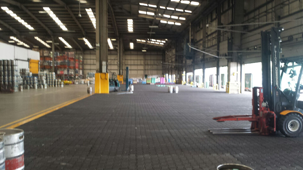 Rubber block pavers installed in a brewery loading bay.