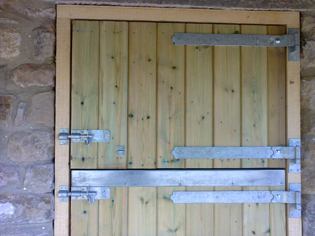 Stable door with heavy duty galvenised hinges and fastenings with chew strip.