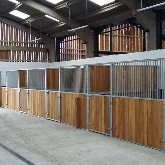 Premier stable system with hardwood timber and round tube infills.