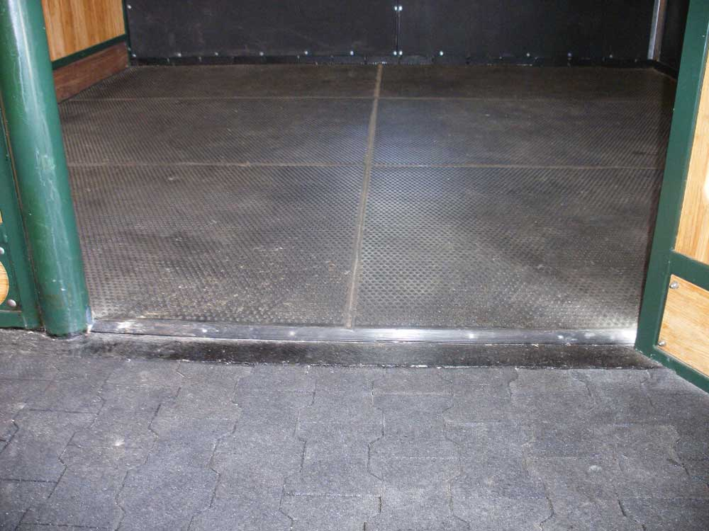 Sealed mats and door strip and block rubber walkway.