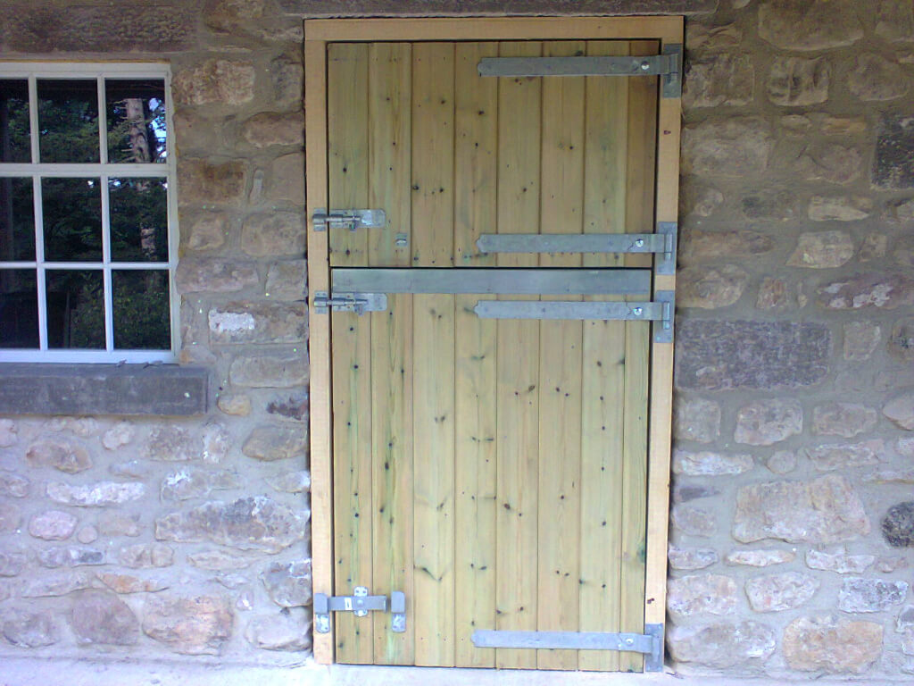 Timber stable door and frame, with chew strip