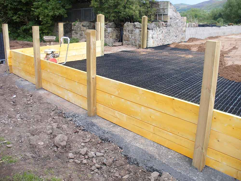 Timber post fencing provides an edge to prevent the the ecogrid shifting.