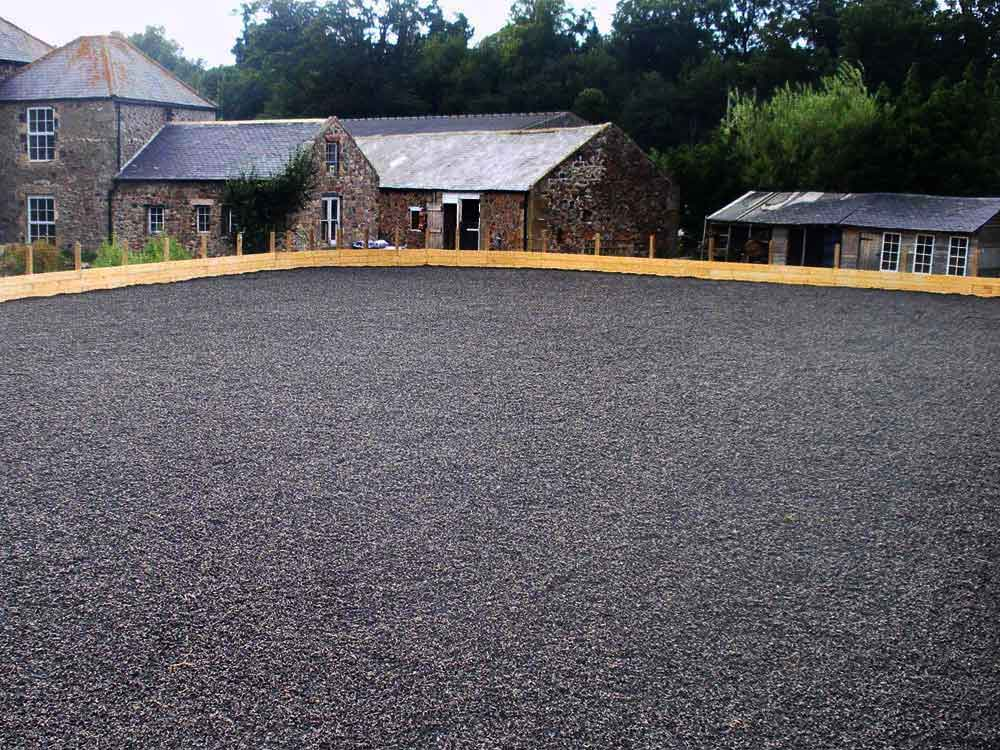 The finished arena with a crumb rubber top surface.